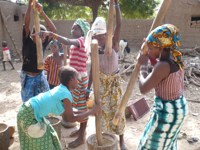 Girls beating millet in a Dogon village