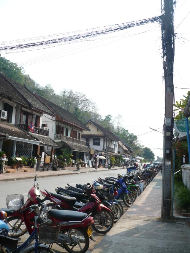Motorbikes line the main street of Luang Prabang.