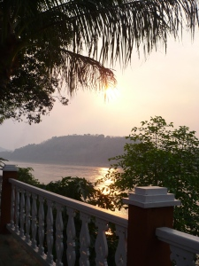 Sun sets over the Mekong in Luang Prabang.