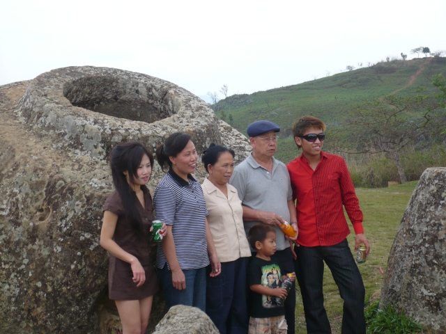 Tourists at the Plain of Jars, in front of a said jar