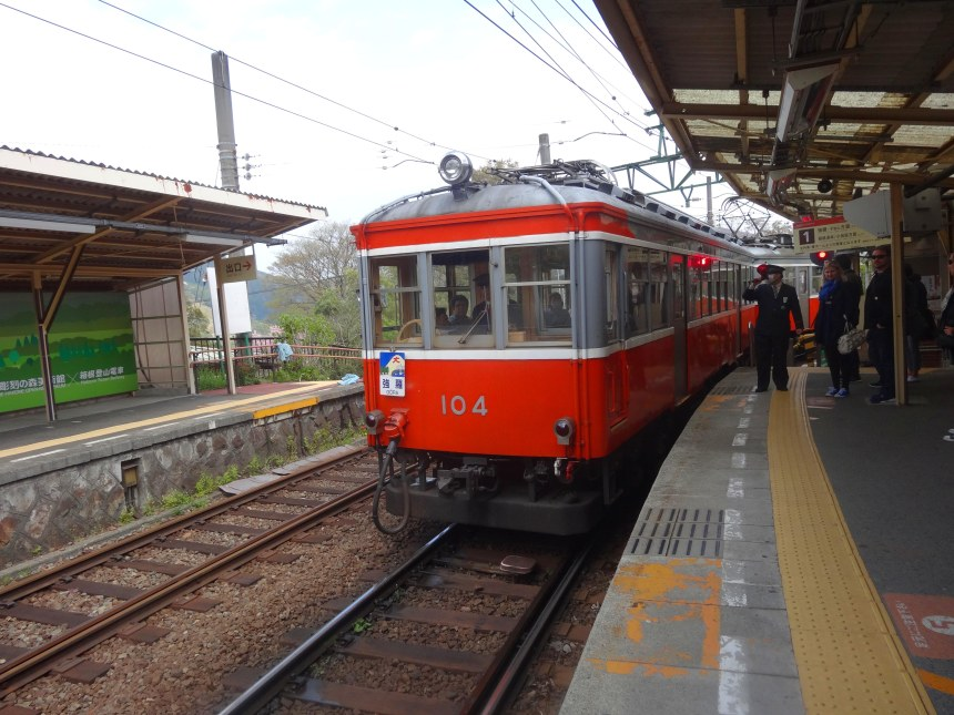 The Hakone Tozan train pulls into a station