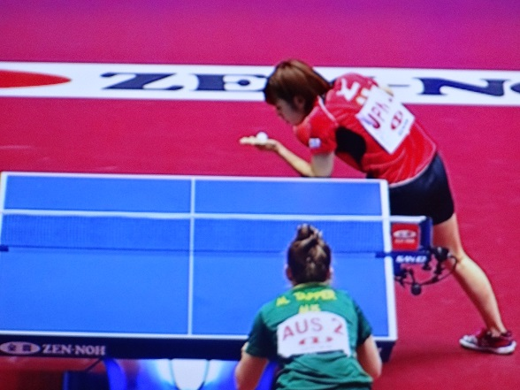 The Japanese player looks sternly at the ball, bending it to her will!