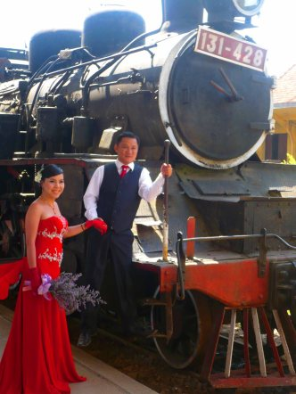 Bride and groom at a train station in Da Lat