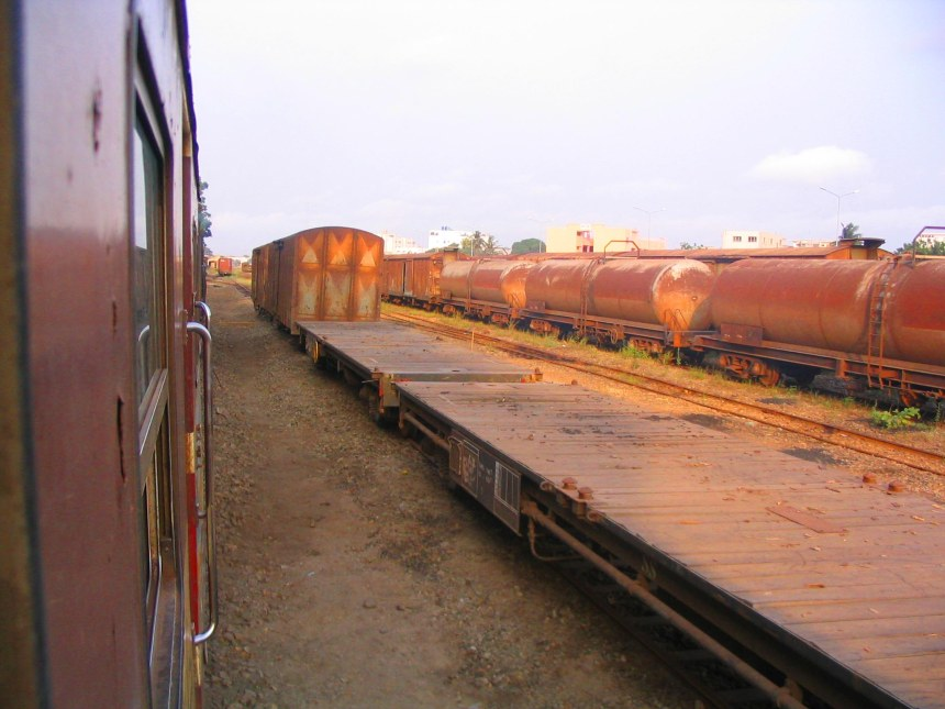 Trucks on the tracks at Cotonou station