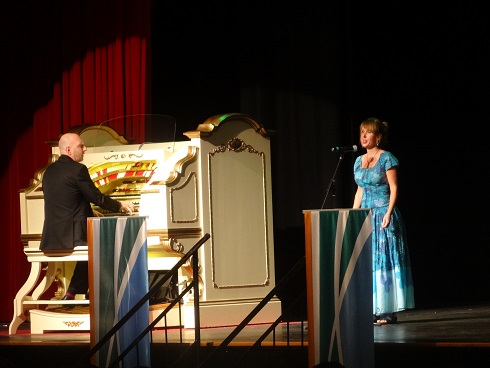 Opera singer with the organist.