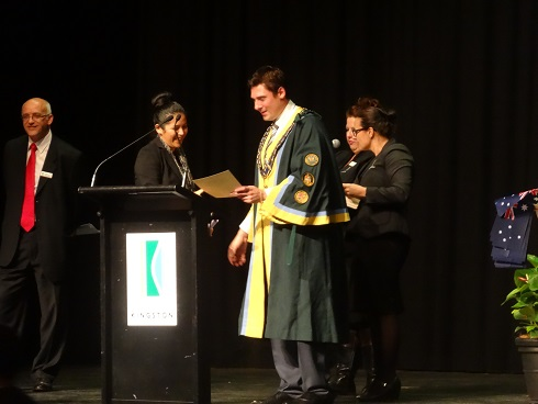 Susy receives her certificate.