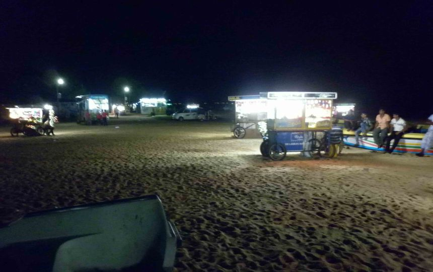 Beach north of Colombo, with vendors ready for hungry visitors
