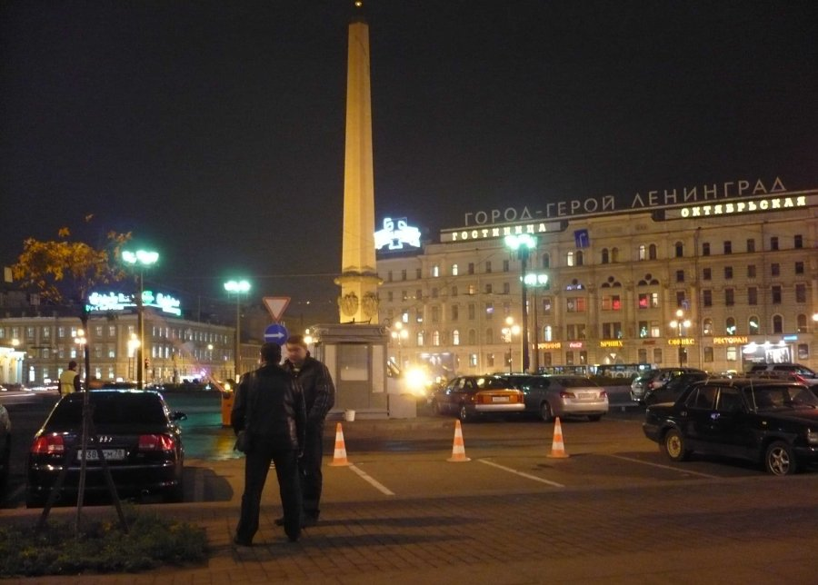 The square outside the station at night