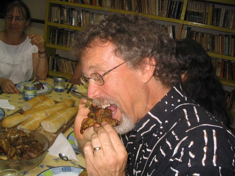 My kindest of kind host in Ouagadougou tucks into some roast chicken.