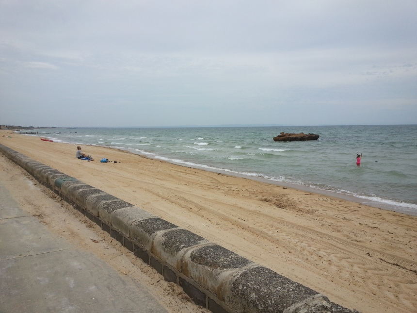 The beach - it is cloudy, but it's still a great place to be December in Australia,