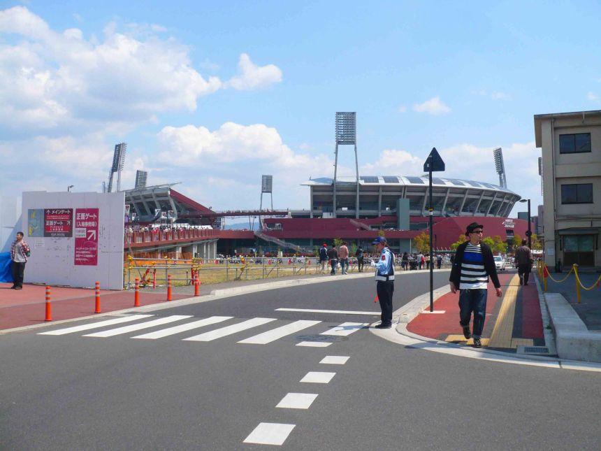 Walking to the baseball stadium.