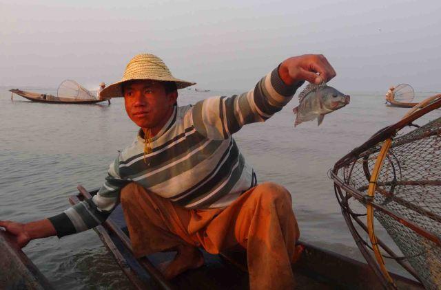 Yep. A real fisherman with a real fish!