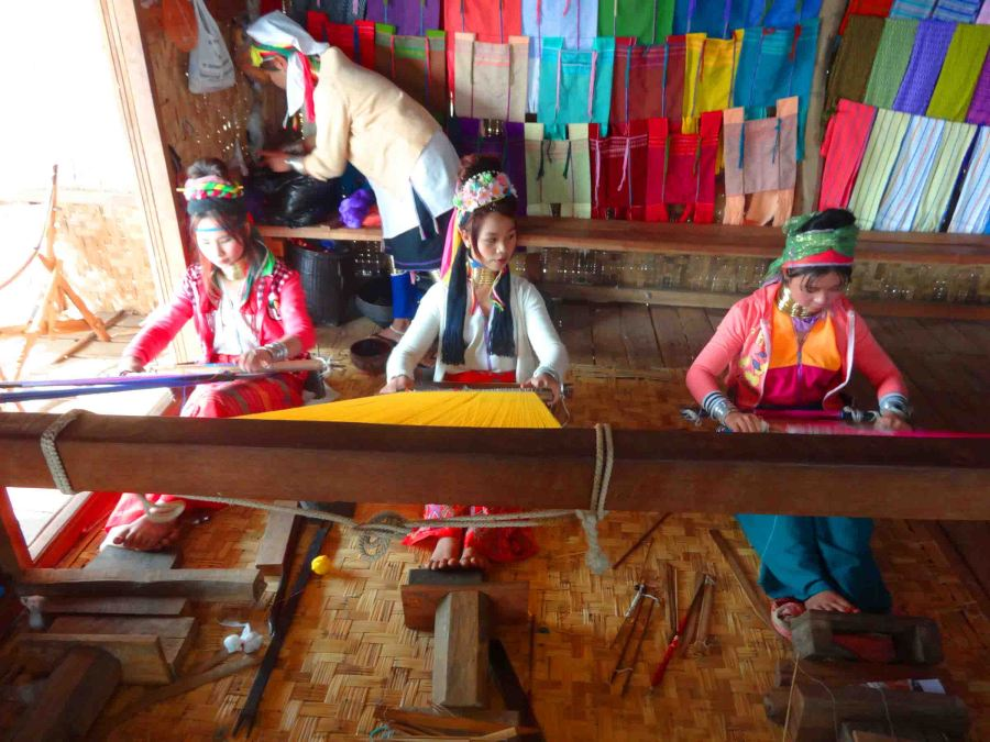 Long necked-women doing some weaving.