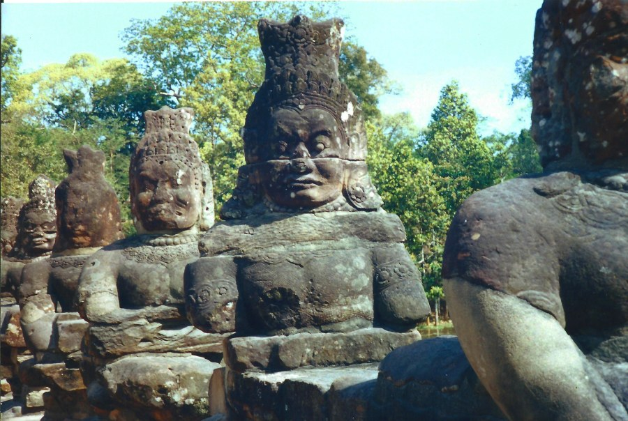 As you cross a bridge in Angkor, these friendly guys greet you