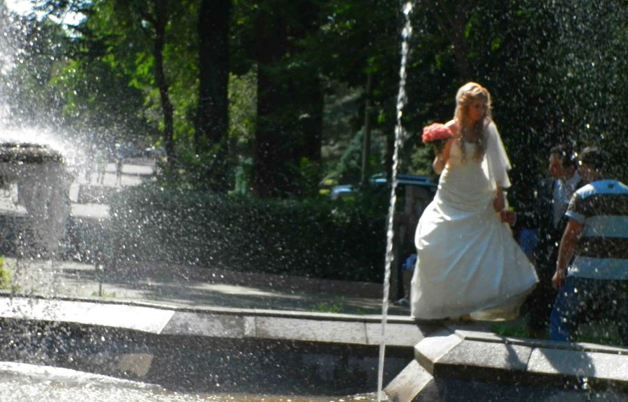 A blurry bride in the park.