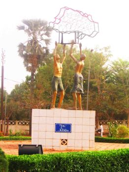Statue in Bobo of two men holding up Burkina Faso