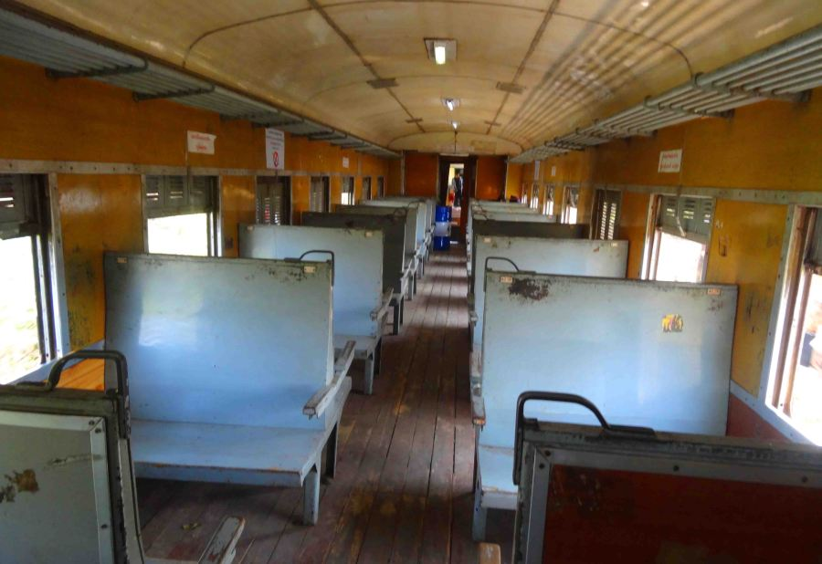 Wooden seats in an empty 2nd Class.