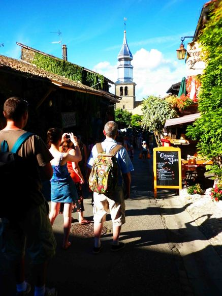 Tourists bustle up and down Yvoire's small streets.
