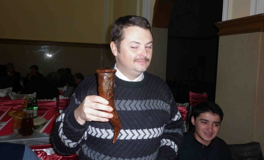 I drink wine from a horn. I was trying a moustache for fun. I have no reasonable excuse for the jumper.