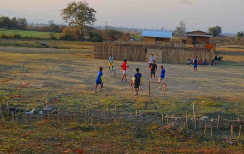 Kids play football as train closes in on Schwenyaung.