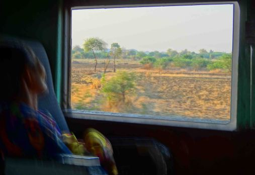 One of my favourite pics. Woman and scenery shortly after leaving Thazi.