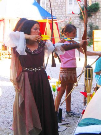 Dress ups and arrows at the Medieval Festival