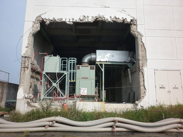 Damage to a factory still unrepaired (and factory not in operation) in Kesenumma, 2012.