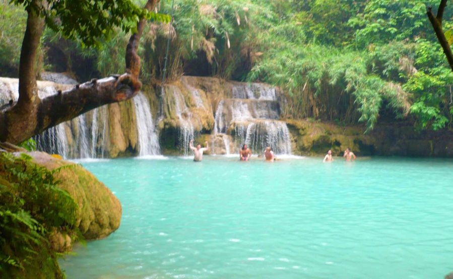 Kuang Si Waterfalls. Awesome to swim below. That IS me holding my arms up.