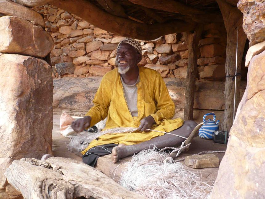 man weaving dogon