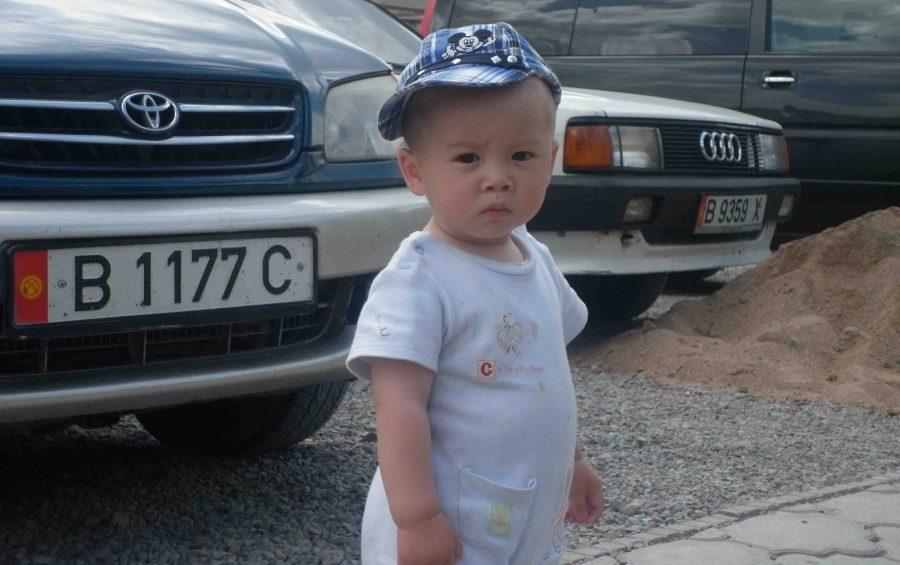 boy on the road to Lake Issyk Kul