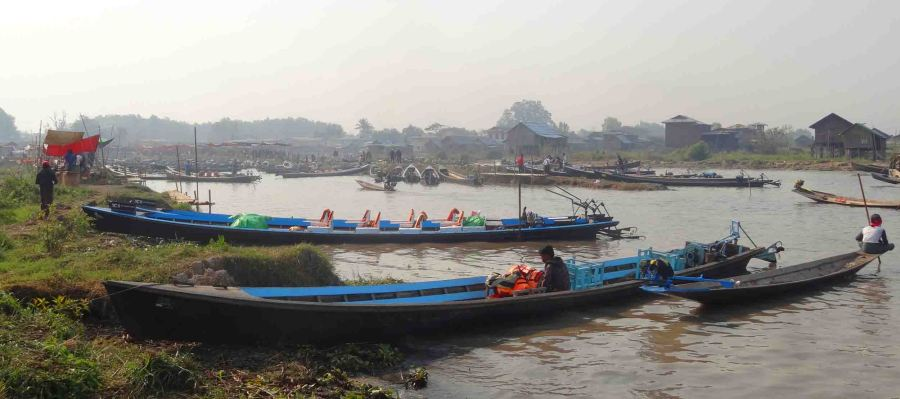 Boats pull in to the market (in the distance) that ferry the tourists around Inle Lake.