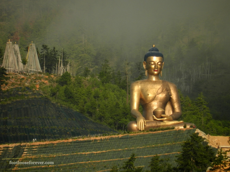 The giant statue of contemplating Buddha gleaming in the rays of morning sun, Thimphu, Bhutan