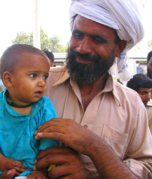 man and child on way to uch shariff