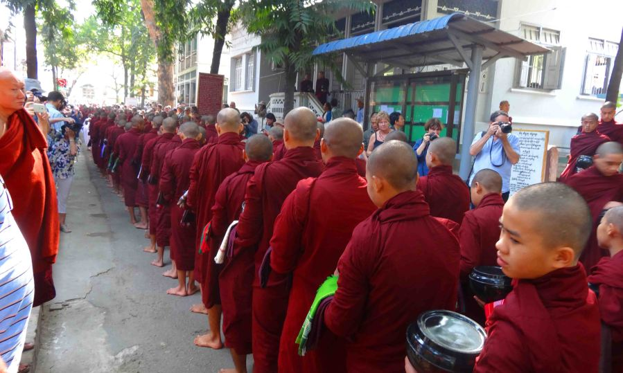 Monks line up for lunch at a temple in Mandalay whilst tourists outnumber them and take their photo. Yes. Like me.
