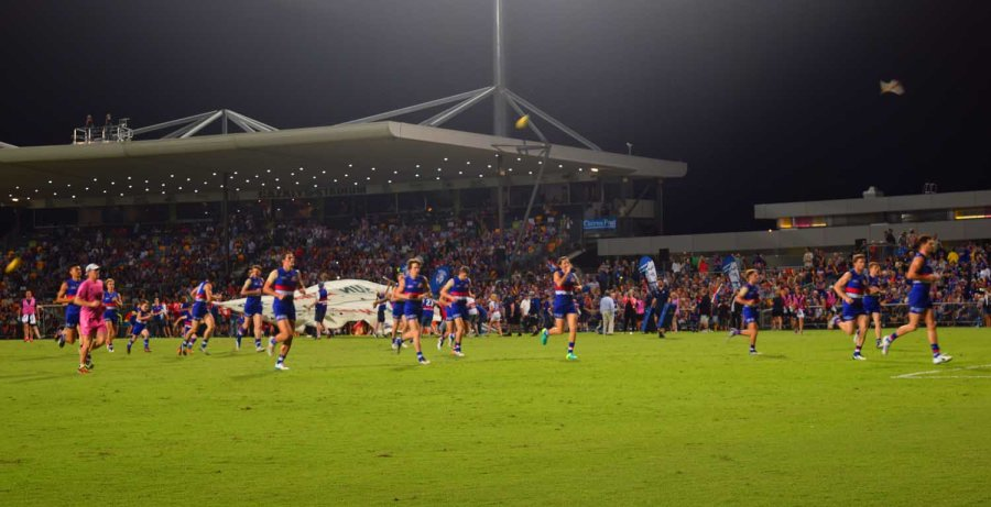 Bulldogs run onto ground.