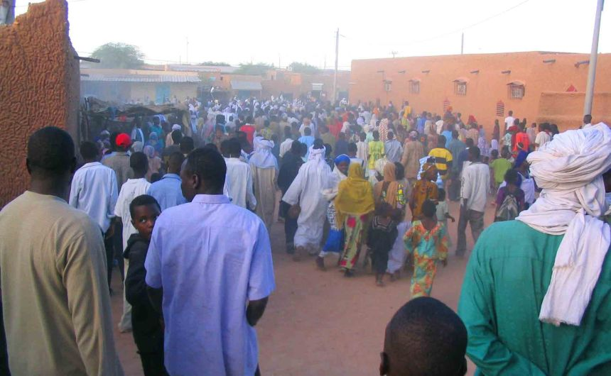 Crowds gather and walk the Agadez streets.