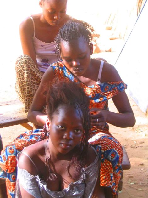 The girls who lived next to Halassi doing their hair.