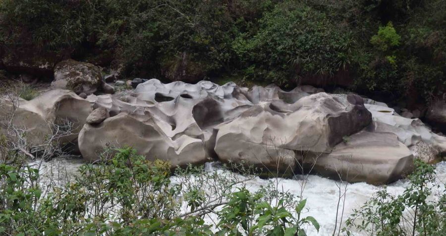 Urumbumba River and some smoothly shaped rocks.